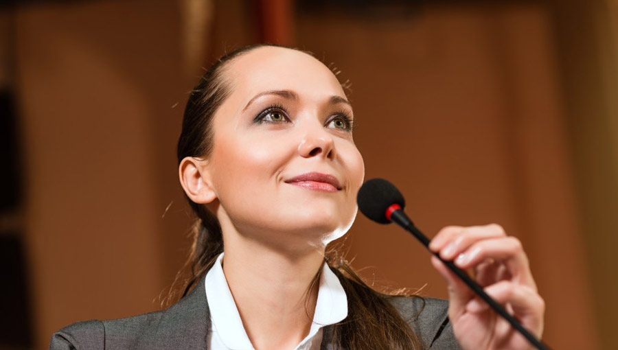 woman-giving-speech-microphone